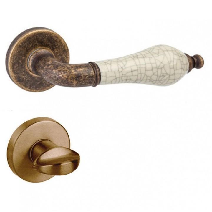 Дверная ручка на розетке DND by Martinelli MONICA античная отделка/бежевый фарфор (с накладкой под WC)467/12T-AF+P8